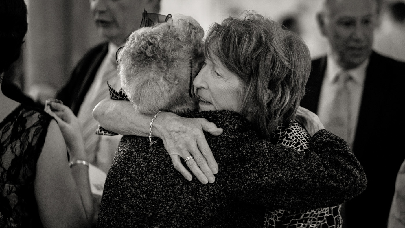 Image of two friends hugging at wedding in Newcastle