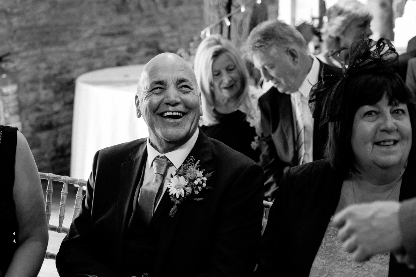 Iamge of groom's father laughing at wedding in yorkshire