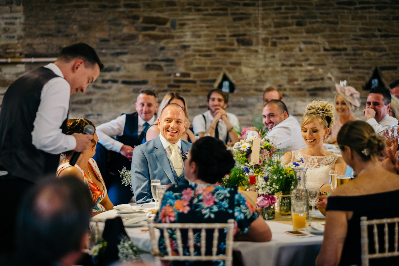 Image of bride and groom laughing a best man speech