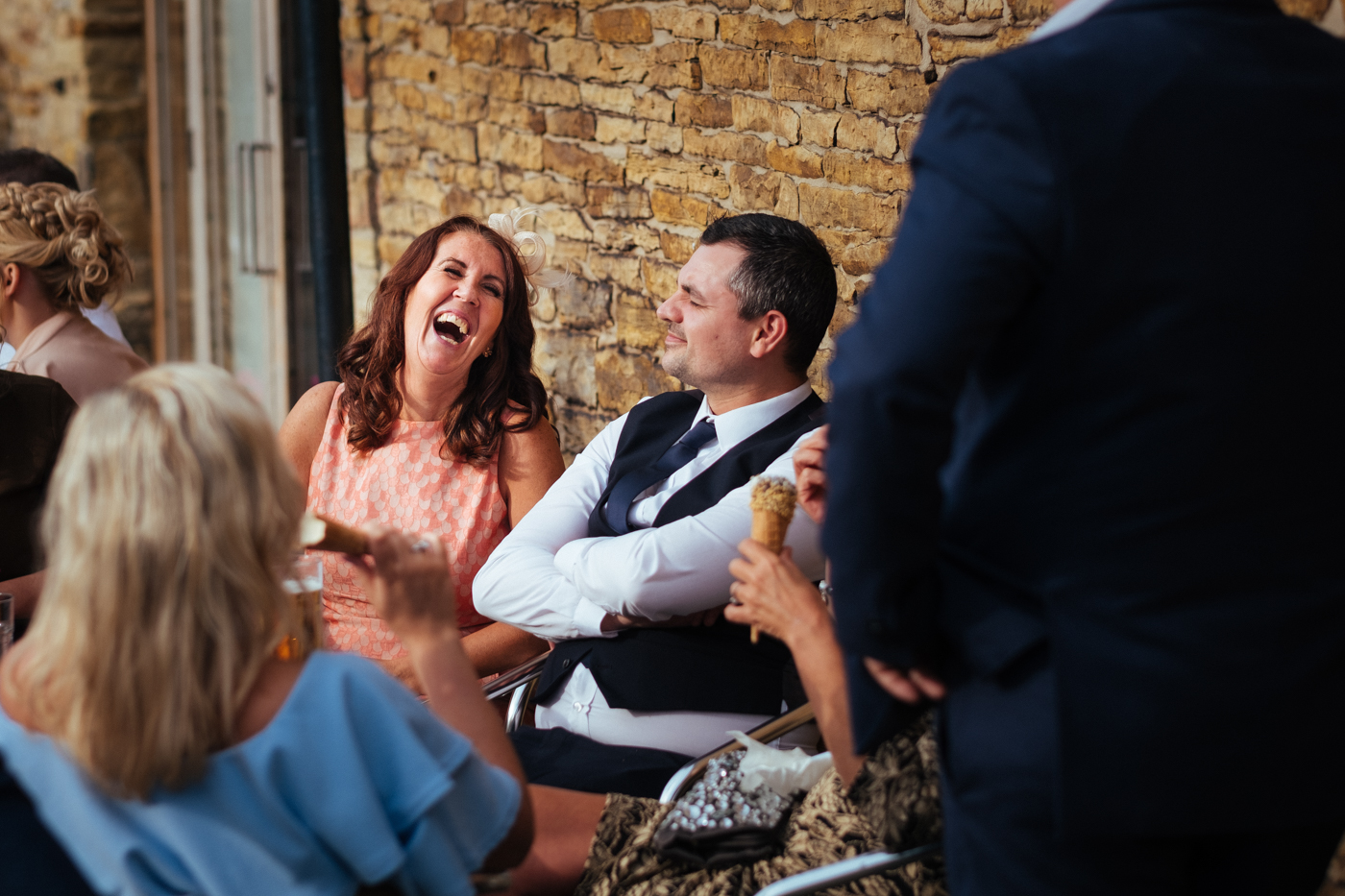 Image of happy lady laughing at wedding