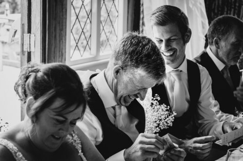 Groom laughs during speeches at wedding