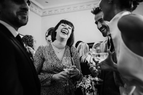 Wedding guests laughing at Middlethorpe Hall in York