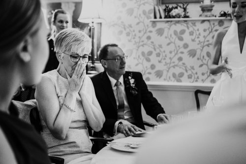 Mother of bride tearful at wedding reception