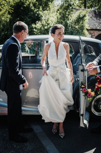 Bride steps out of Bentley at st everilda church nether poppleton