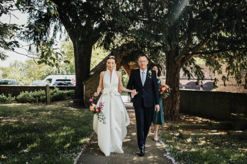 Bride and father walk to st everilda church in nether poppleton